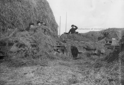 Pz Kpfw I and II's camouflaged with straw.
