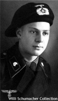 Pre-war or early-war portrait of an enlisted panzer crewman in his black panzer uniform and beret.