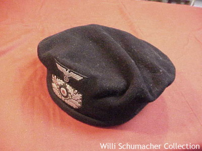 Army Black Panzer Beret showing the cover and insignia on the front.