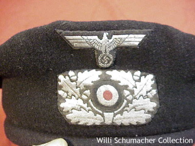 Close up of the machine-woven insignia on the front of the Army black panzer beret. Notice that the insignia background color is gray-green for regular caps and not black for the panzer beret.