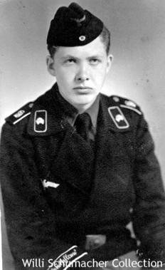 Army enlisted black Panzer uniform showing the jacket with insignia. Notice the skull collar tabs, which were a standard feature on these uniforms. This enlisted man was in the Army's elite Grossdeutschland Panzer Division as noted by the cuffband in Sütterlin script and the embroidered GD monograms on the shoulder straps.
