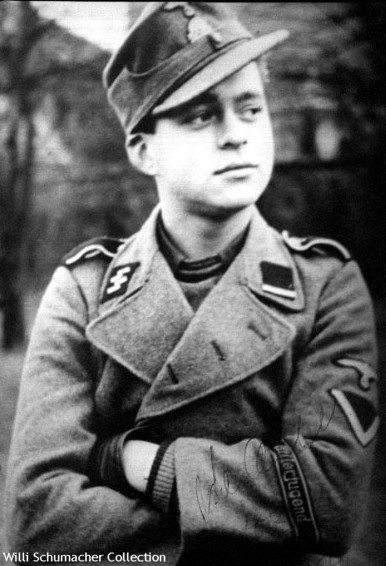 "SS-Sturmmann Hans Joachin Katschinski, an assault gunner in the 12. SS-Panzer-Division ""Hitlerjugend"" wears the one-button model of the M1943 field cap with two-piece insignia."