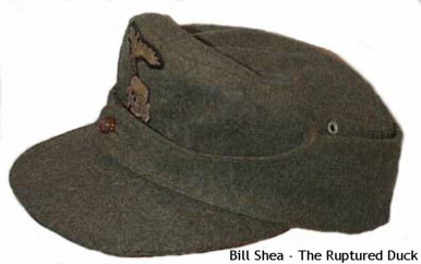 Waffen-SS Enlisted M1943 Field Cap – one button model with two-piece Bevo insignia.