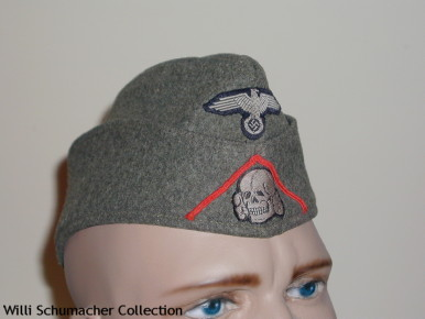 Example of a Waffen-SS enlisted overseas cap with a red soutache for artillery. The soutache were ordered removed by SS-Hauptamt (SS-Main Department) in November 1940, as well as a return to white piping on all service caps. This cap is stenciled inside with a 1940 date.