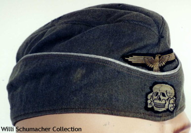Example of a Waffen-SS officer overseas cap. This cap has the aluminum wire piping denoting an officer cap but has the distinctive enlisted machine-woven insignia. This was a common practice during the war.