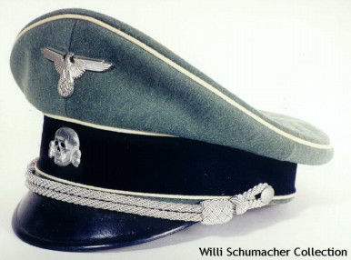 Example of a Waffen-SS officer service cap. The standard was white piping around the crown and above and below the black felt cap band. For a period of 8 months in 1940, ending in November, members of the Waffen-SS were authorized to wear caps with various colored piping representing their branch, e.g. red for artillery, black for engineers, etc. The insignia is stamped aluminum and the silver bullion chin cords are attached on each side with silver pebbled buttons.