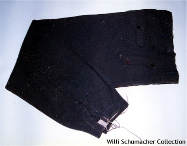 Waffen-SS Assault Gun Trousers were designed after their Army counterparts but with the addition of a button on the forward facing front pocket flaps – having two buttons – one on each side versus a single button in the center.
