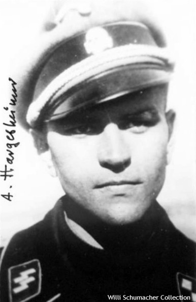 SS-Untersturmführer Hargesheimer, panzer commander wearing the Waffen-SS Officer Service Cap with the silver bullion chin cords. Notice the wire inside the crown has been removed so the cap does not maintain its rigid form and that the wings on the national emblem have been bent back.
