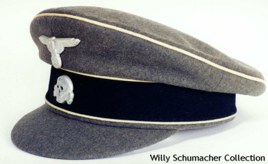 This is an example of the Old Style Service Cap as worn by many Waffen-SS NCOs in the early days of the SS-VT and Waffen-SS. The visor is covered in gray-green wool just like the rest of the cap. There is no chin cord. White waffenfarben was the normal branch color although during the authorized period in 1940, other branch colors were worn. These, and the crusher styled caps, were very popular with the assault gun crews because of their softness and flexibility.