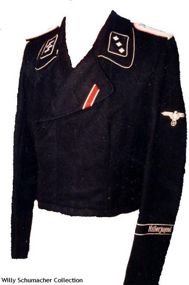 "An SS-Untersturmführer of Panzer black wraparound jacket from SS-Panzer-Regiment 12, 12. SS-Panzer-Division ""Hitlerjugend""."
