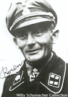 "Schwerterträger SS-Sturmbannführer of Panzer Georg Bochmann wearing the officer black panzer jacket with aluminum piping around the collar. Notice the Totenkopf collar tab denoting the 3. SS-Panzer-Division ""Totenkopf""."
