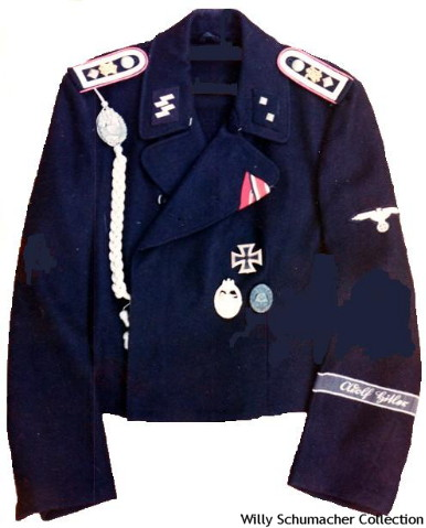 "An SS-Oberscharführer of Panzer black wraparound jacket from SS-Panzer-Regiment 1, 1. SS-Panzer-Division ""Leibstandarte SS Adolf Hitler"". This jacket has the slip on shoulder straps with the metal LAH ciphers, the panzer lanyard, and Adolf Hitler cuffband. The ribbons in the buttonhole are the Iron Cross Second Class and the Russian Front Winter Campaign Medal 1941/42. Badges include the Iron Cross First Class, Panzer Assault Badge and Wound Badge in Black."